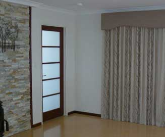 Lounge Room Curtains and great floors call For lovely flooring call Rian's Window Treatments